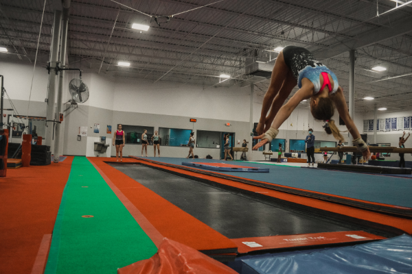 A team athlete flipping off the Tumbl Trak into foam pit